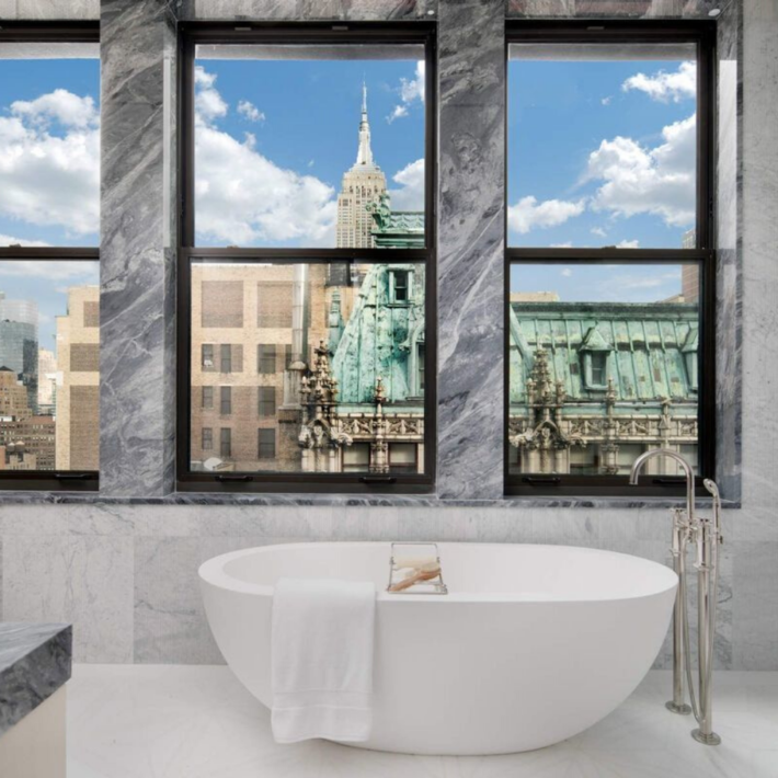 An apartment on 5th Avenue in New York City, a bathroom with the view over the city