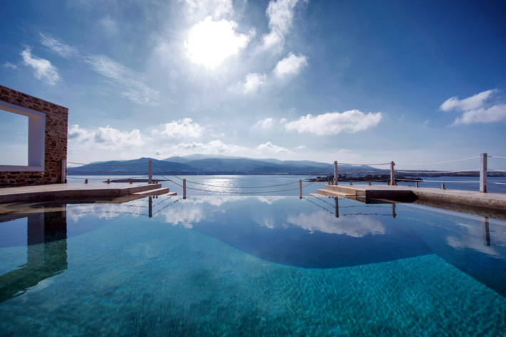 Best infinity pools in the world: one of the best infinity edge plunge pools located in a villa in Greece, the concentration of the best infinity pools with a view. The infinity pools makes an illusion of the sky touching the ocean.