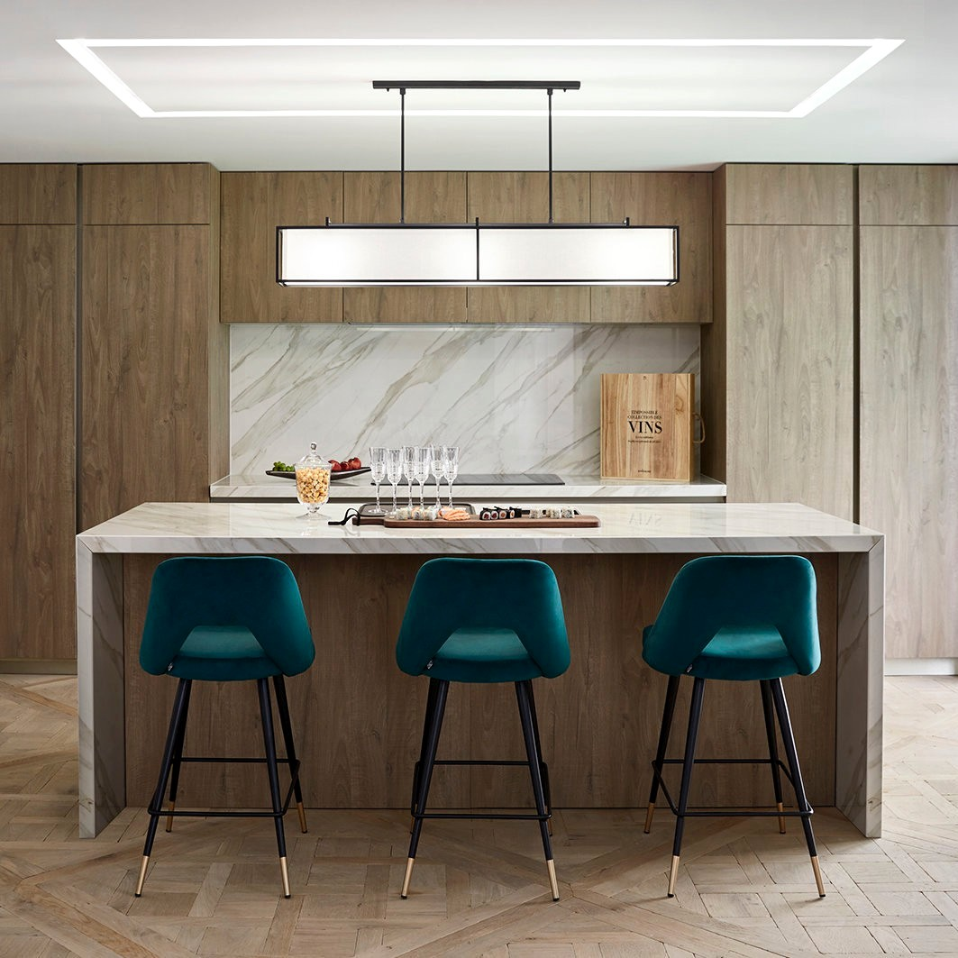 Luxury home bar decor: black stools, dining tables and pool tables, kitchen cabinets.