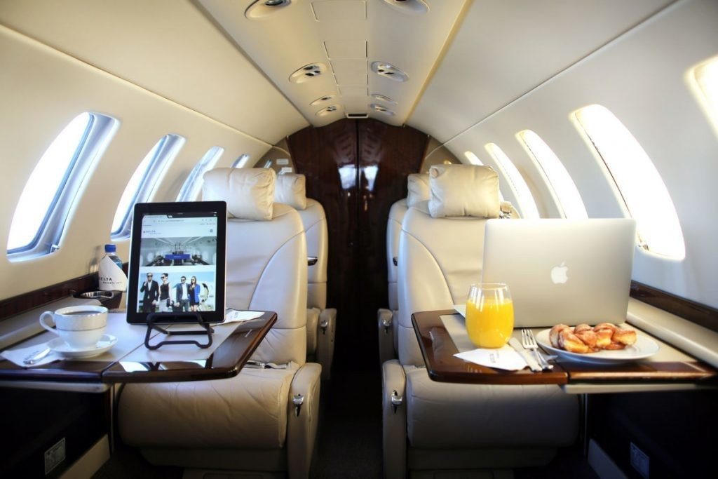 Small private airplane with master bedroom and kitchen: floor plan