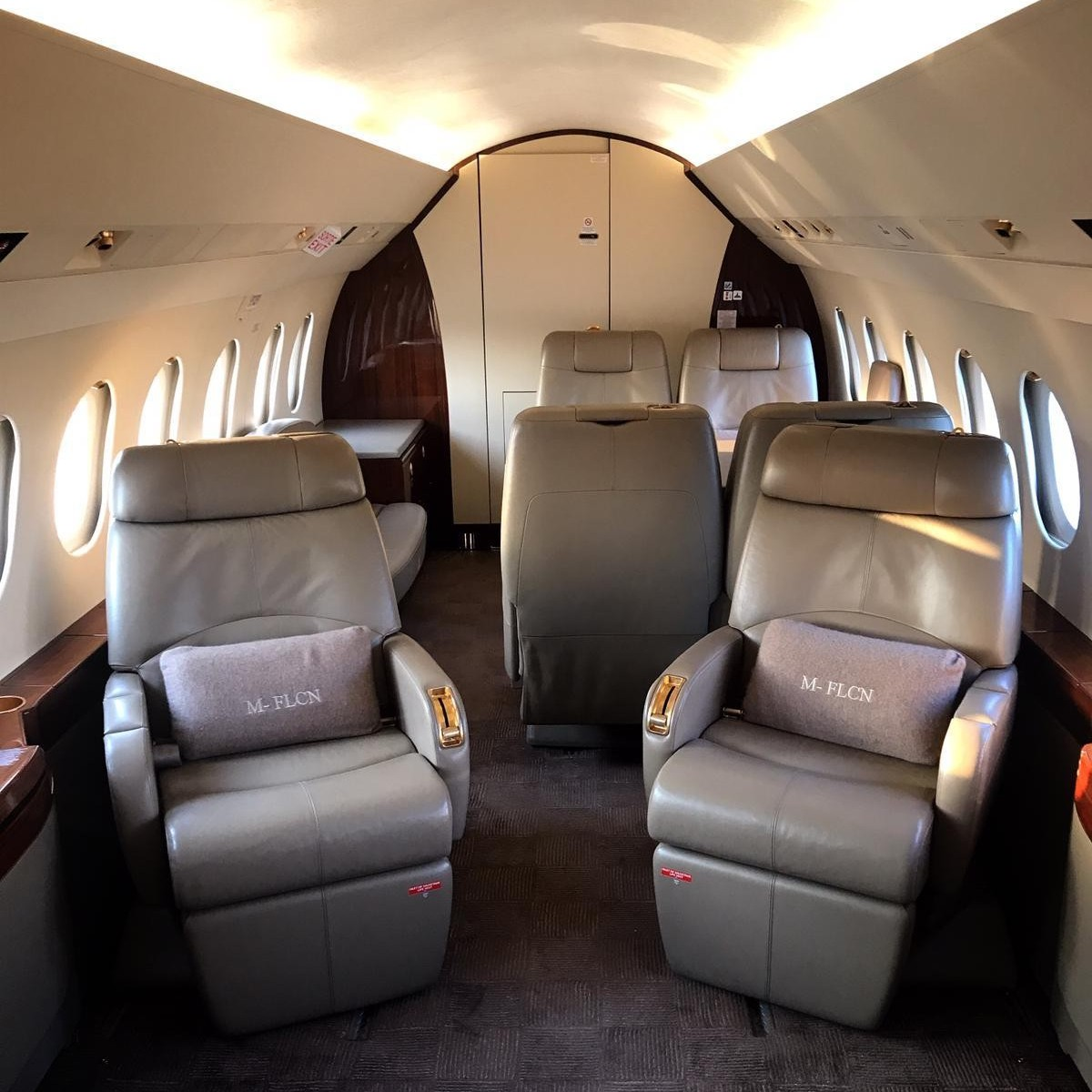 Huge private jets with a twin bed bedroom, master bedroom and couch