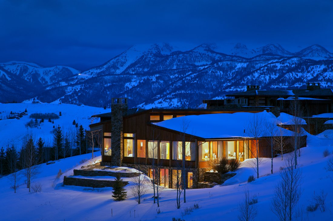 Luxury mountain homes with wooden balconies in Colorado mountains and North Carolina mountains.