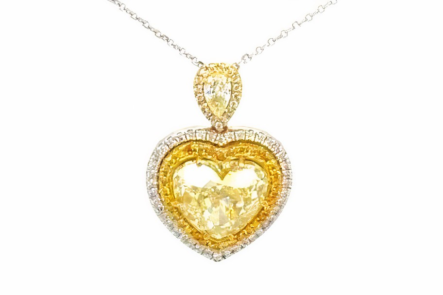 How are yellow diamonds formed, and are yellow diamonds cheaper than other colored gems?